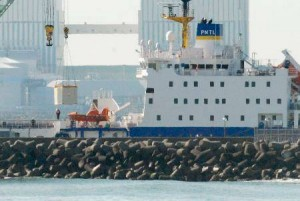 Tokai Mura nuclear dock. Pacific Egret loads one of at least seven containers. [photo from Kyodo News]